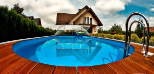 Telescopic swimming pool enclosure