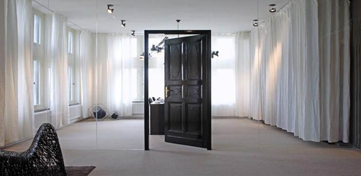 Mirrored wall with door opening into another room