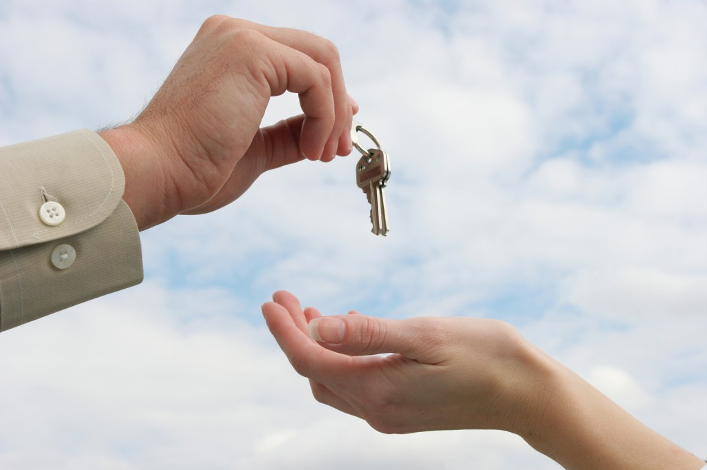 Handing-over-house-keys-to-new-owner