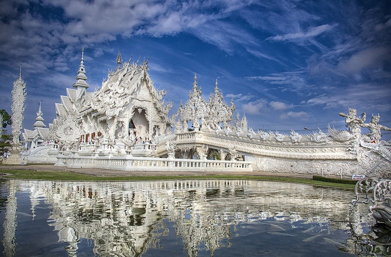 View of Wat Rong Khun,  a Buddhist Temple in Chiang Rai, which is very popular amongst foreign tourists at the White Temple.